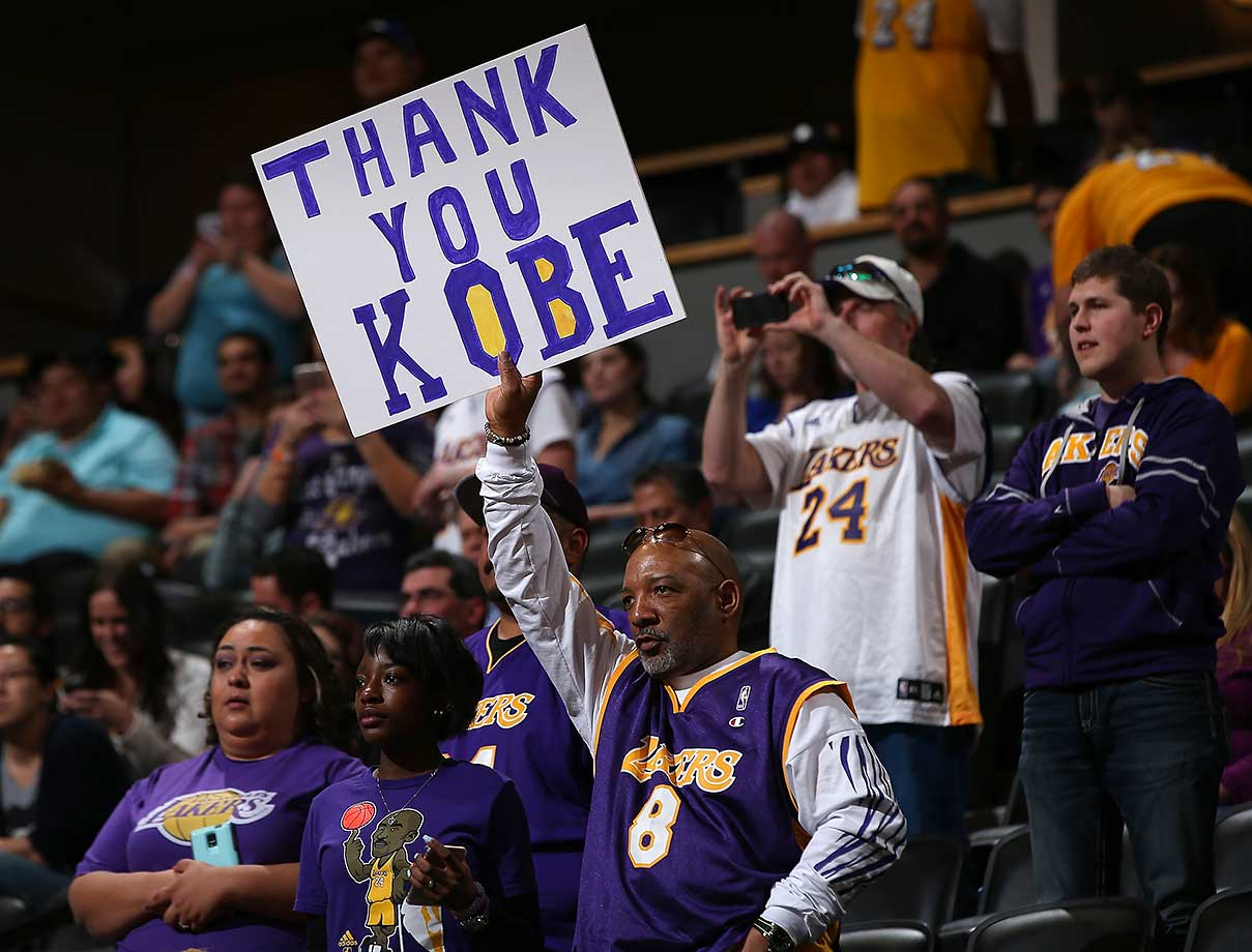 A fan displays a sign in support of Kobe Bryant as he played in Denver for the final time.