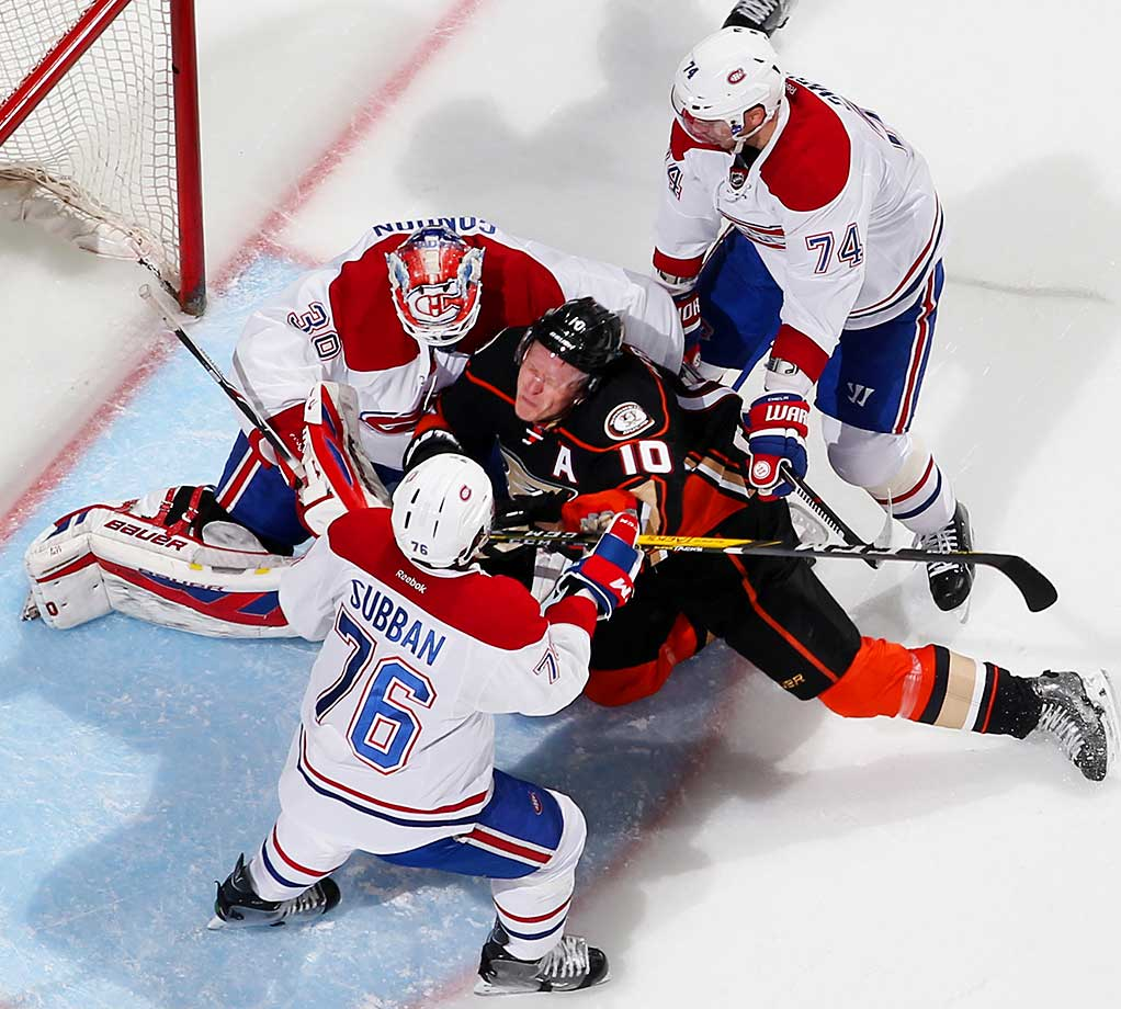 Corey Perry of Anaheim gets sandwiched by Alexei Emelin, P.K. Subban and Mike Condon of Montreal.