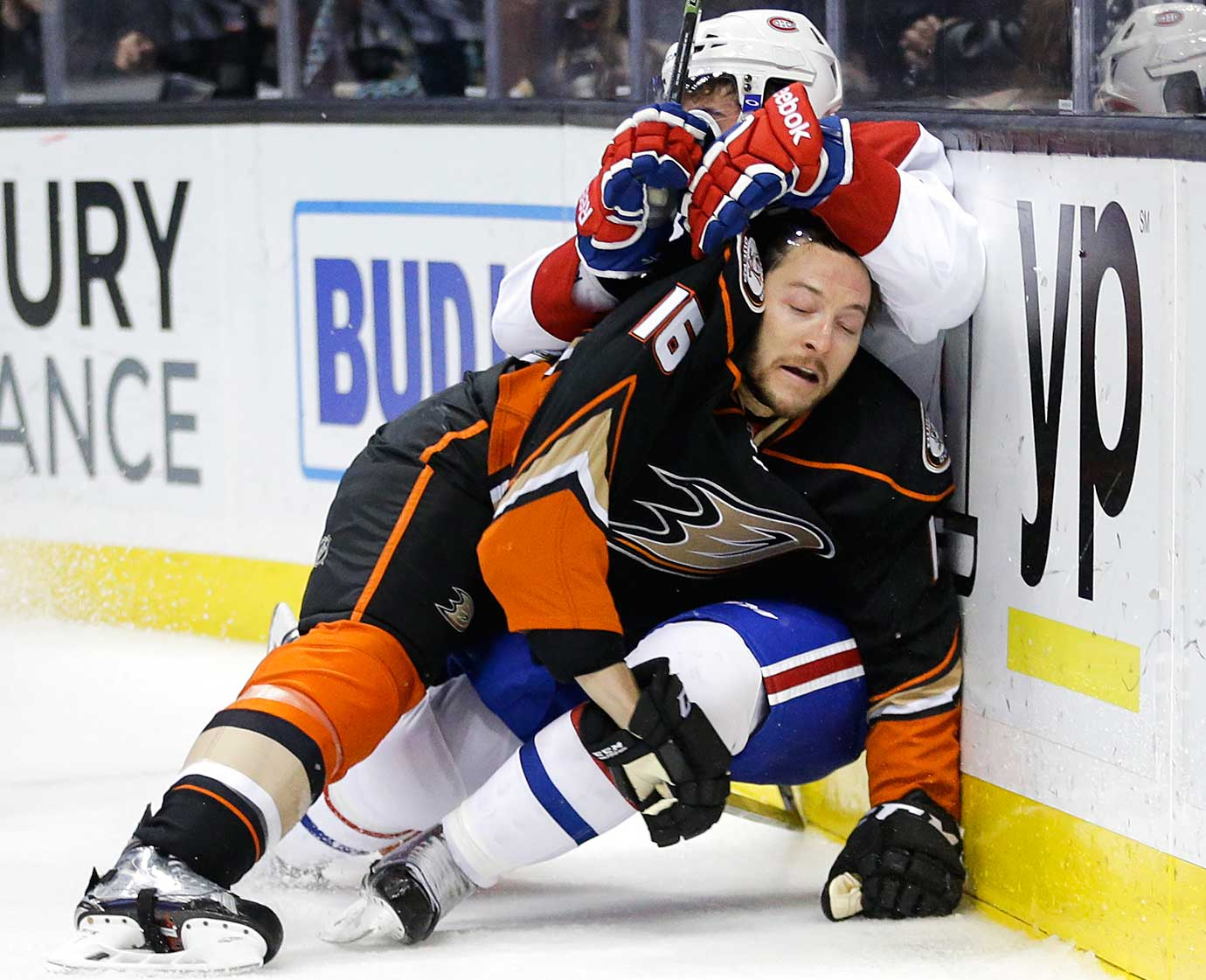 Ryan Garbutt of Anaheim gets hit by Phillip Danault of the Montreal Canadiens.