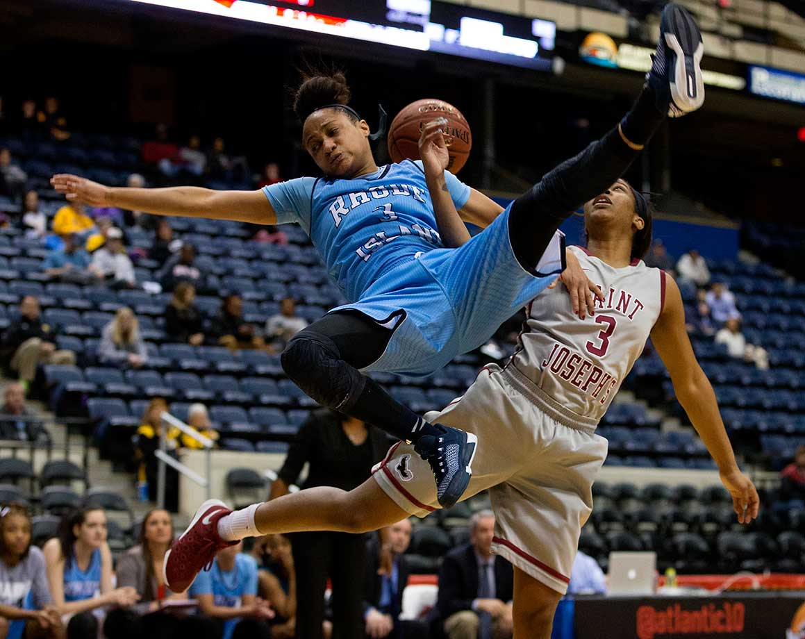Charise Wilson of Rhode Island collides with Ciara Andrews of the Saint Joseph's Hawks.