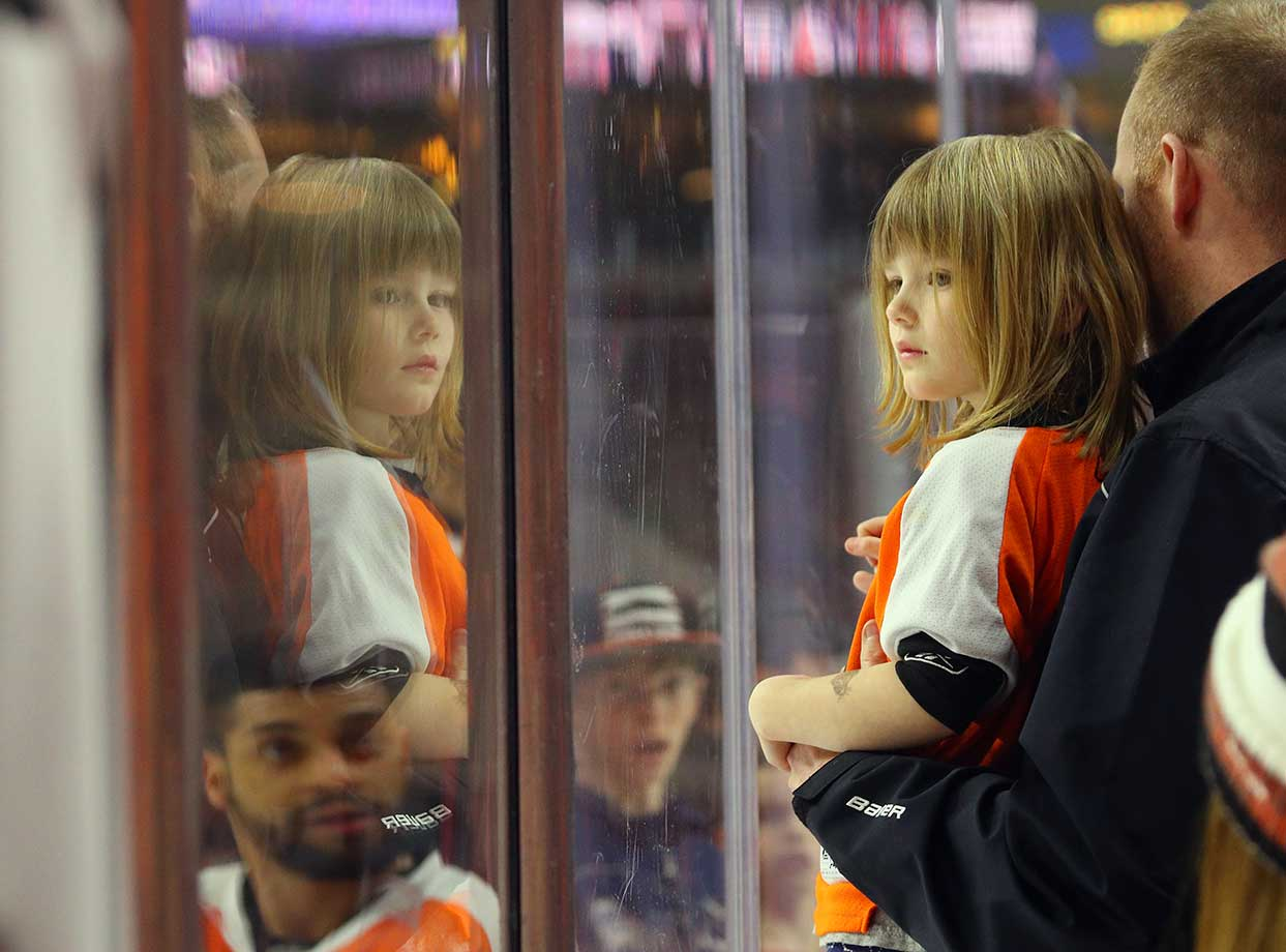 A young fan watches warmups prior to the game between Philadelphia and Edmonton.