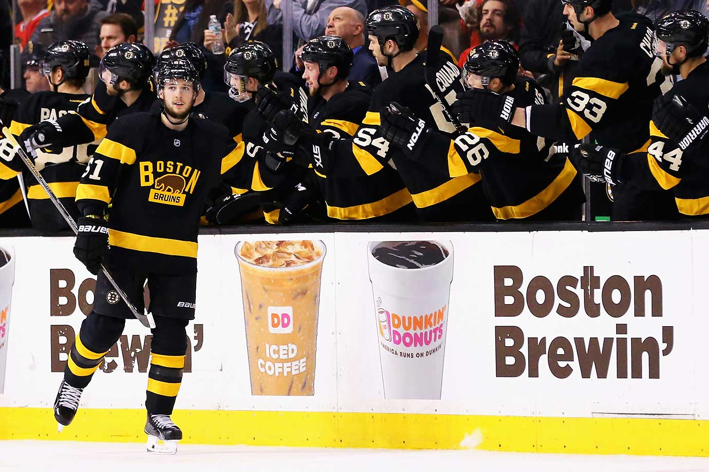 Bruins management and Dunkin' Donuts with a bit of clever advertising at TD Garden.