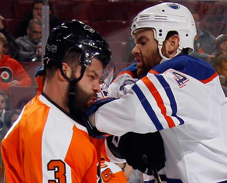 Zack Kassian of Edmonton gets the elbow up on Radko Gudas of the Philadelphia Flyers.