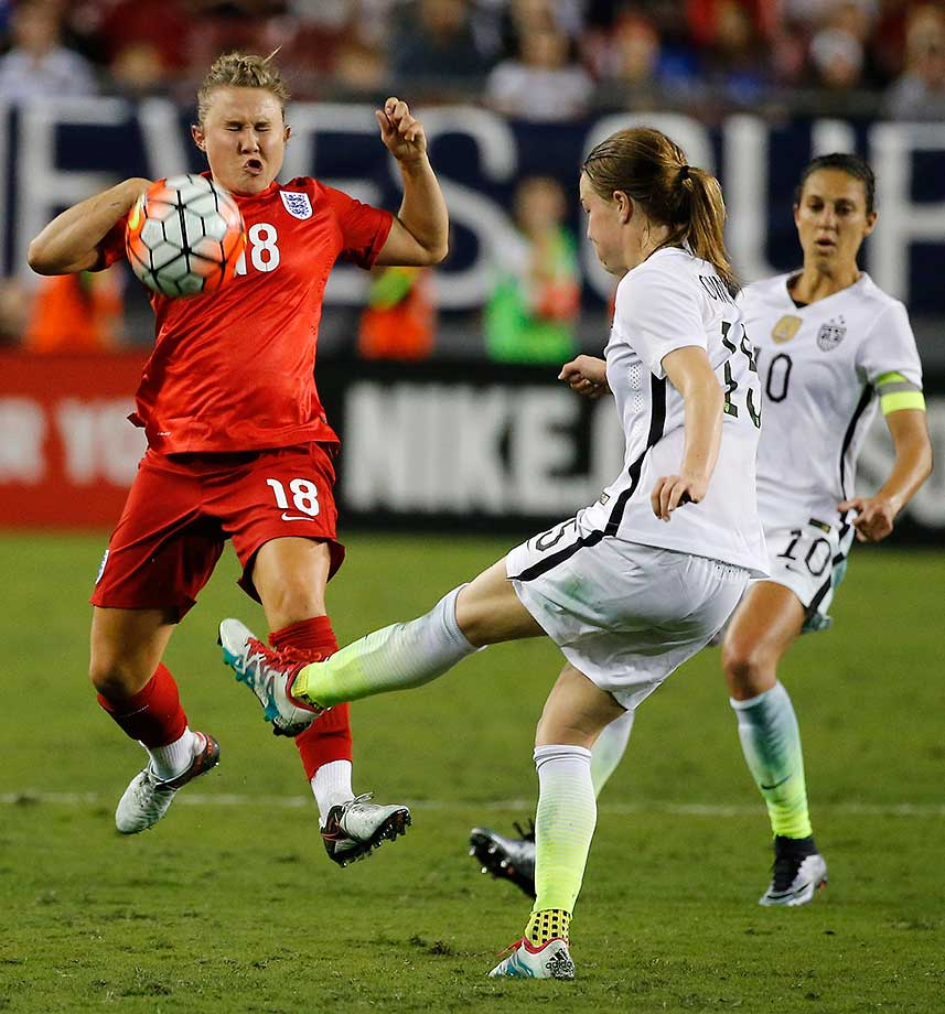 England's Izzy Christiansen blocks a kick from Emily Sonnett of the U.S. during their SheBelieves Cup match.