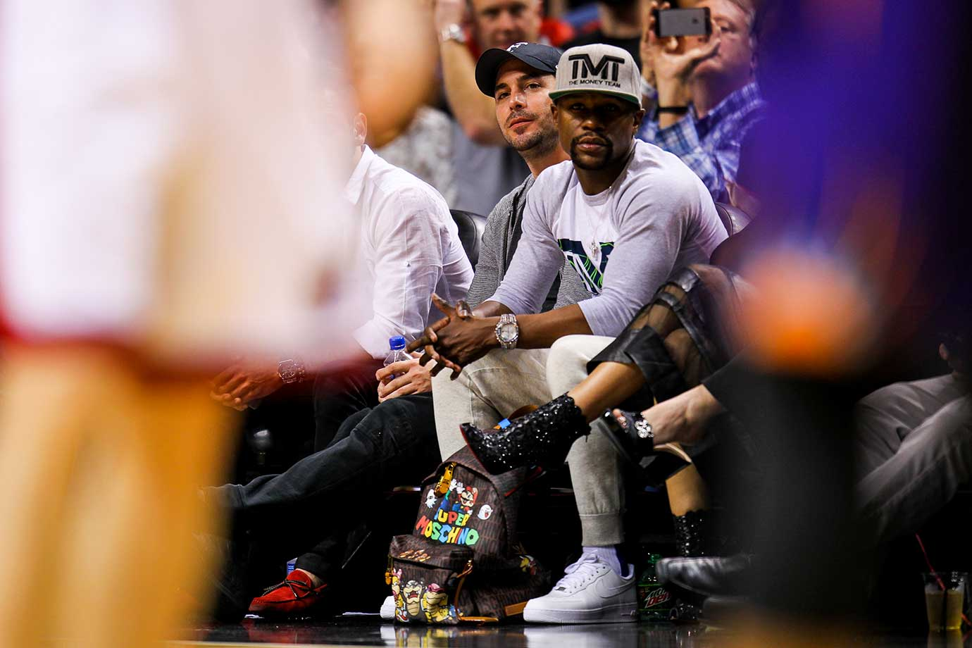 Floyd Mayweather Jr. watches the game between the Miami Heat and the Phoenix Suns.
