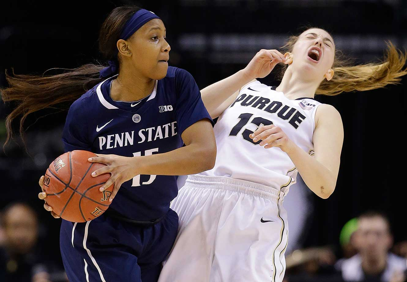 Purdue's Bridget Perry appears to have caught an elbow while defending Penn State's Kaliyah Mitchell.