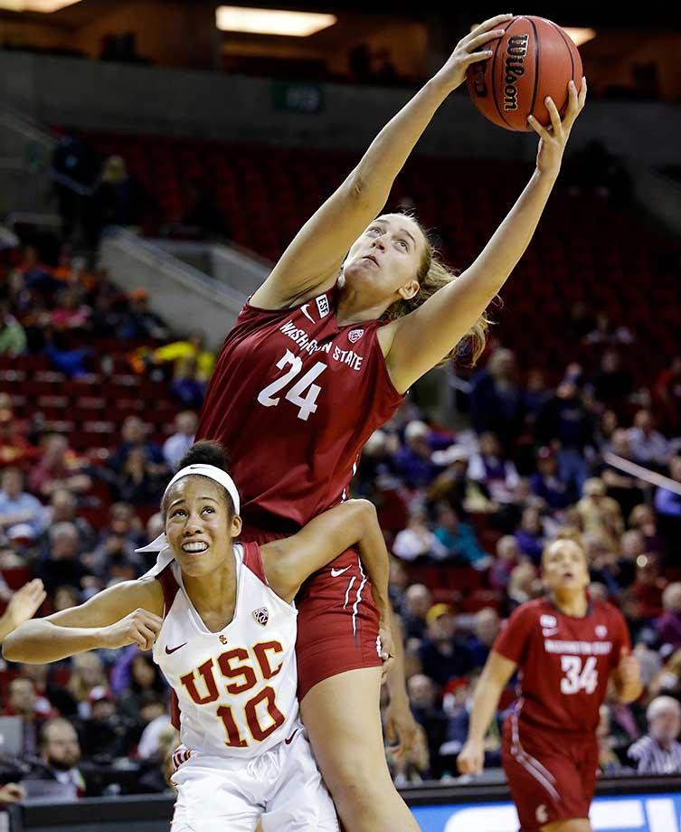 Washington State's Bianca Blanaru grabs a rebound over Southern California's Courtney Jaco.