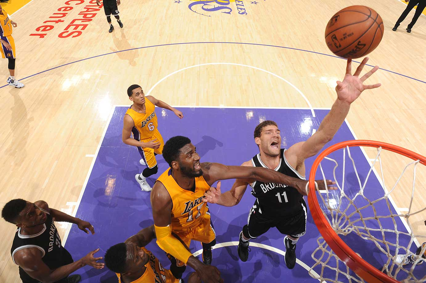 Brook Lopez put back a layup with 0.4 seconds left in overtime to give Brooklyn a 121-120 win over Denver.