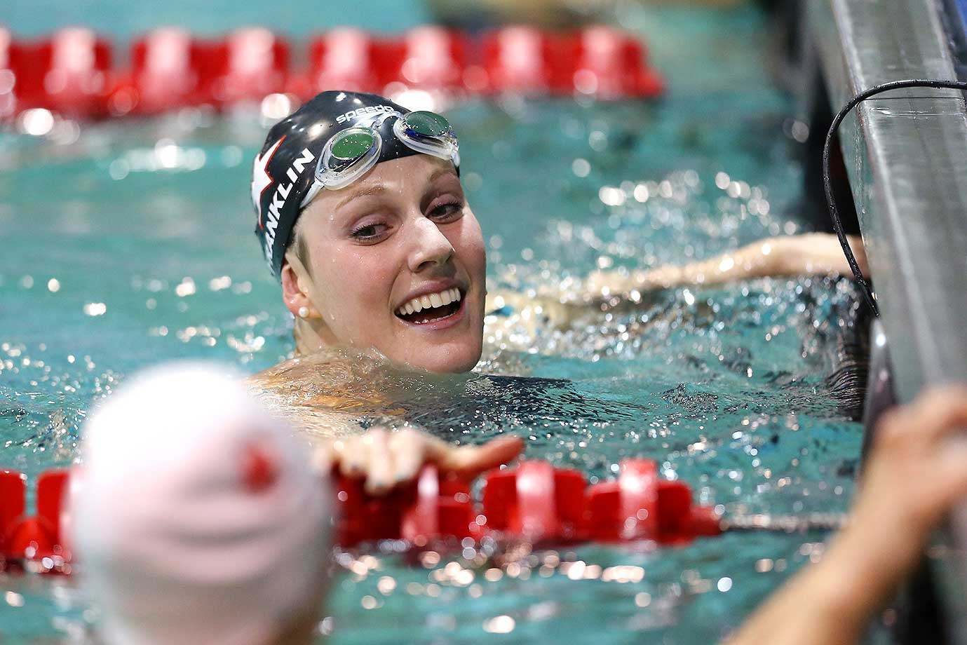 Missy Franklin smiles after the 50 LC meter freestyle final at the Arena Pro Swim Series in Orlando.