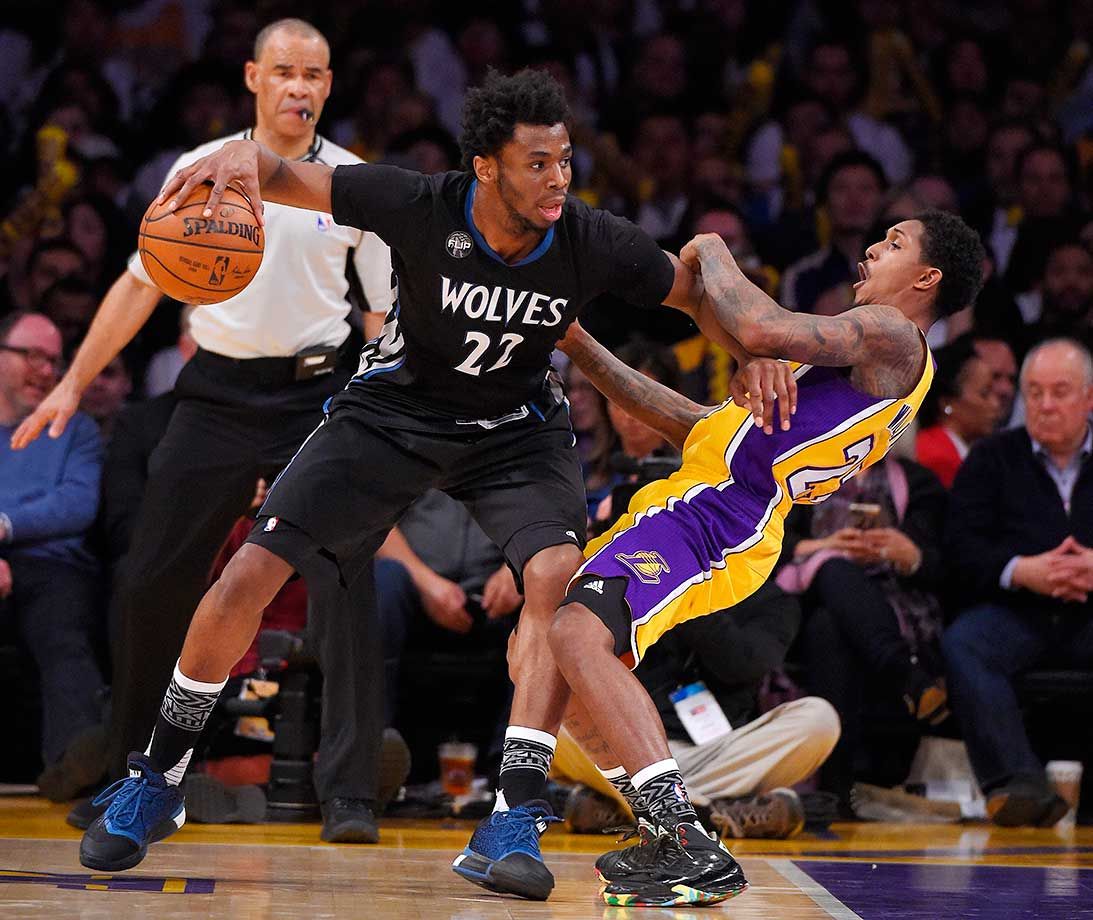 Los Angeles Lakers guard Louis Williams falls while trying to guard Minnesota Timberwolves guard Andrew Wiggins in Los Angeles. The Lakers won 119-115.