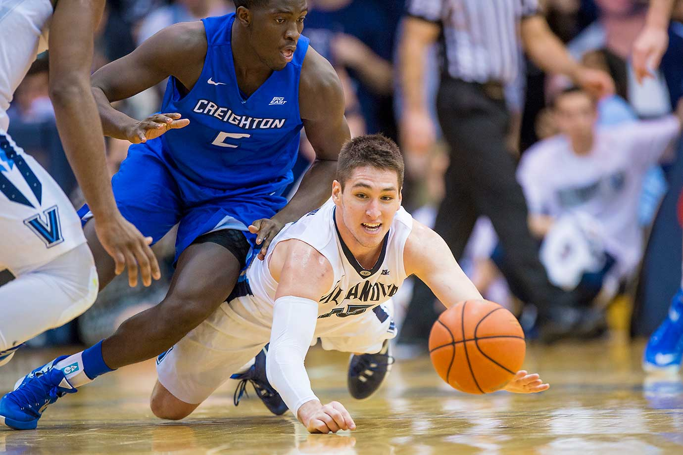 Villanova Wildcats guard Ryan Arcidiacono dives after the loose ball during a game against the Creighton Bluejays at the Pavilion in Villanova, Penn.
