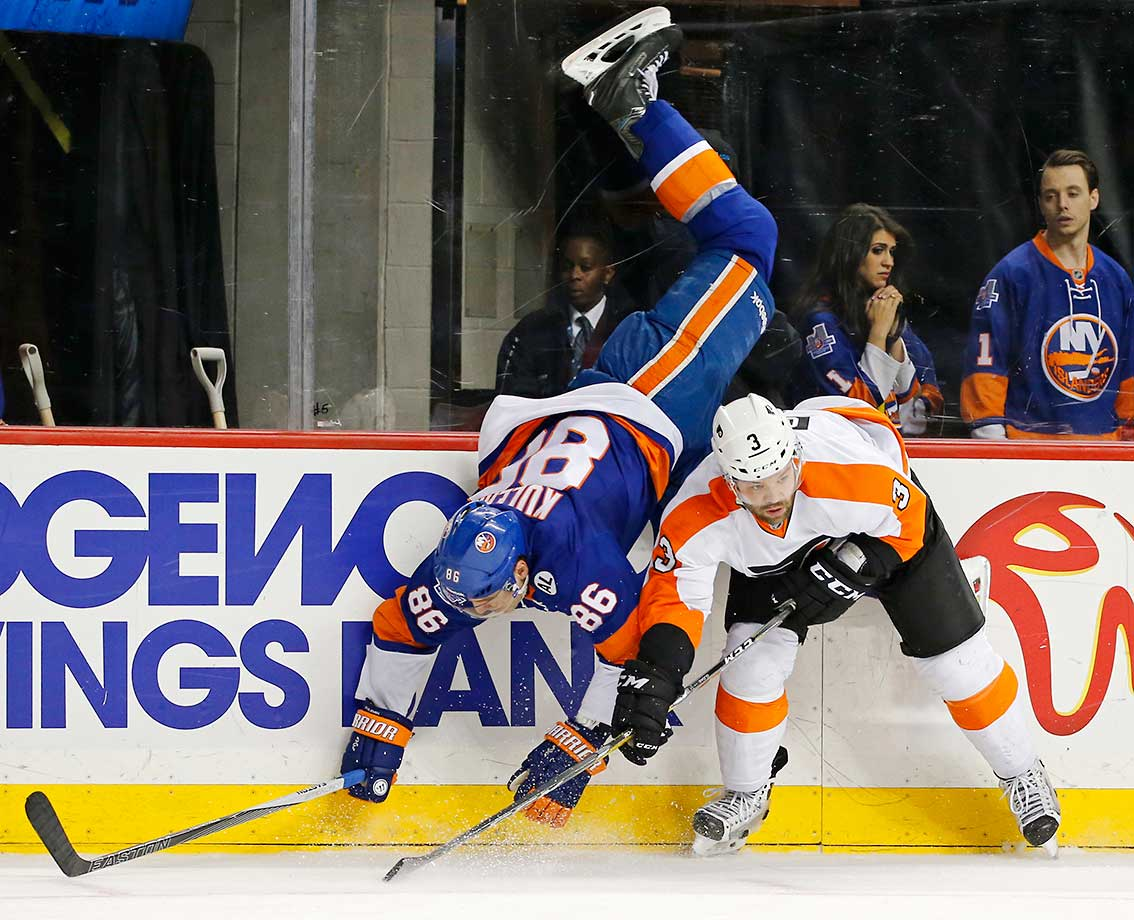 Nikolay Kulemin of the New York Islanders is upended by Philadelphia Flyers defenseman Radko Gudas.