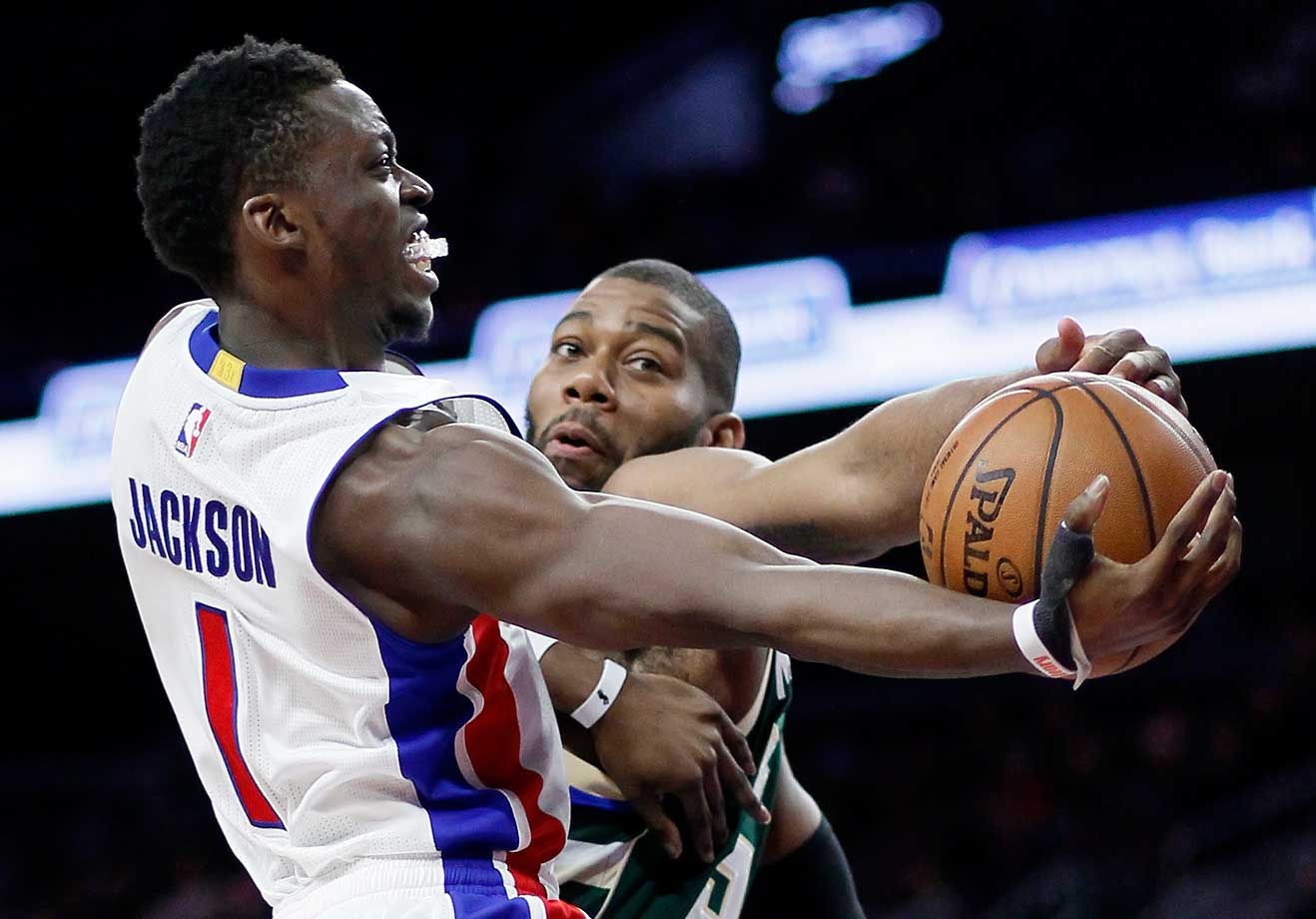 Detroit's Reggie Jackson goes to the basket against Milwaukee's Greg Monroe.