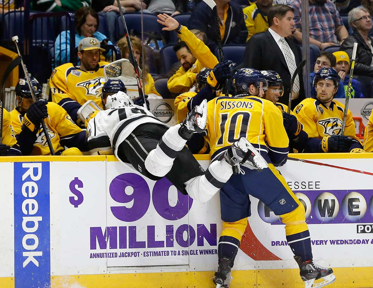 Nashville's Colton Sissons checks Los Angeles Kings left wing Dwight King into the Predators' bench.