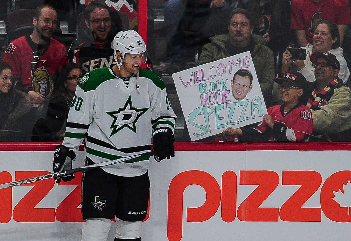 A young Sens fan holds up a poster for Dallas Stars center Jason Spezza in Ottawa, Ontario, Canada.
