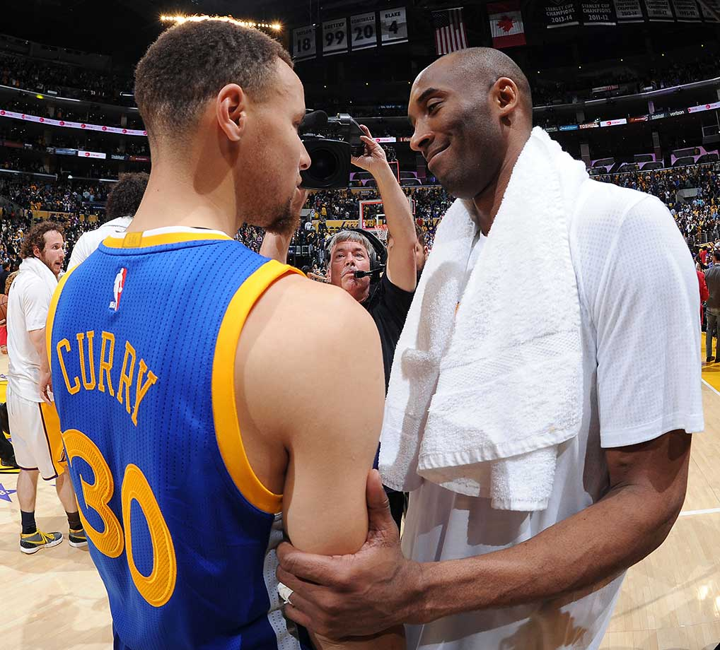 Kobe Bryant and Steph Curry talking after their game in Los Angeles.