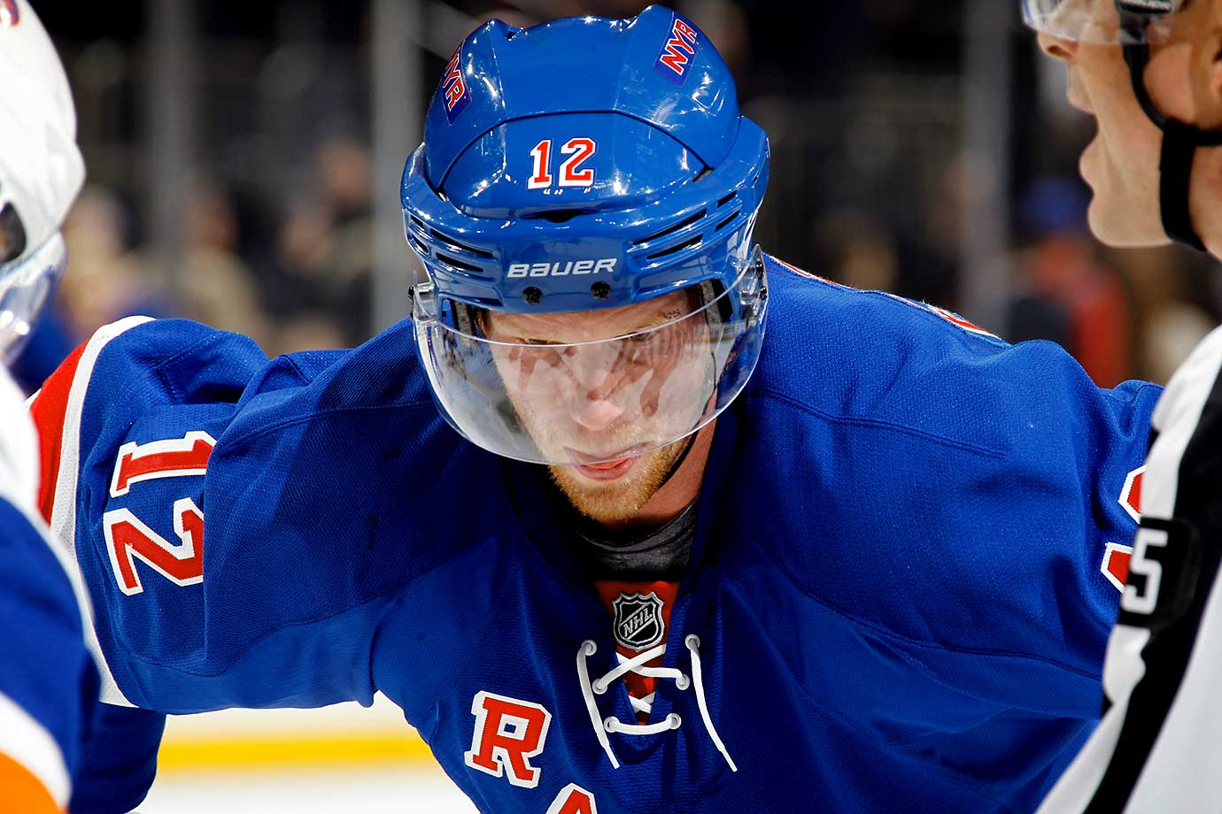 A reflection sits on the mask of Eric Staal of the New York Rangers during a face-off against the New York Islanders.