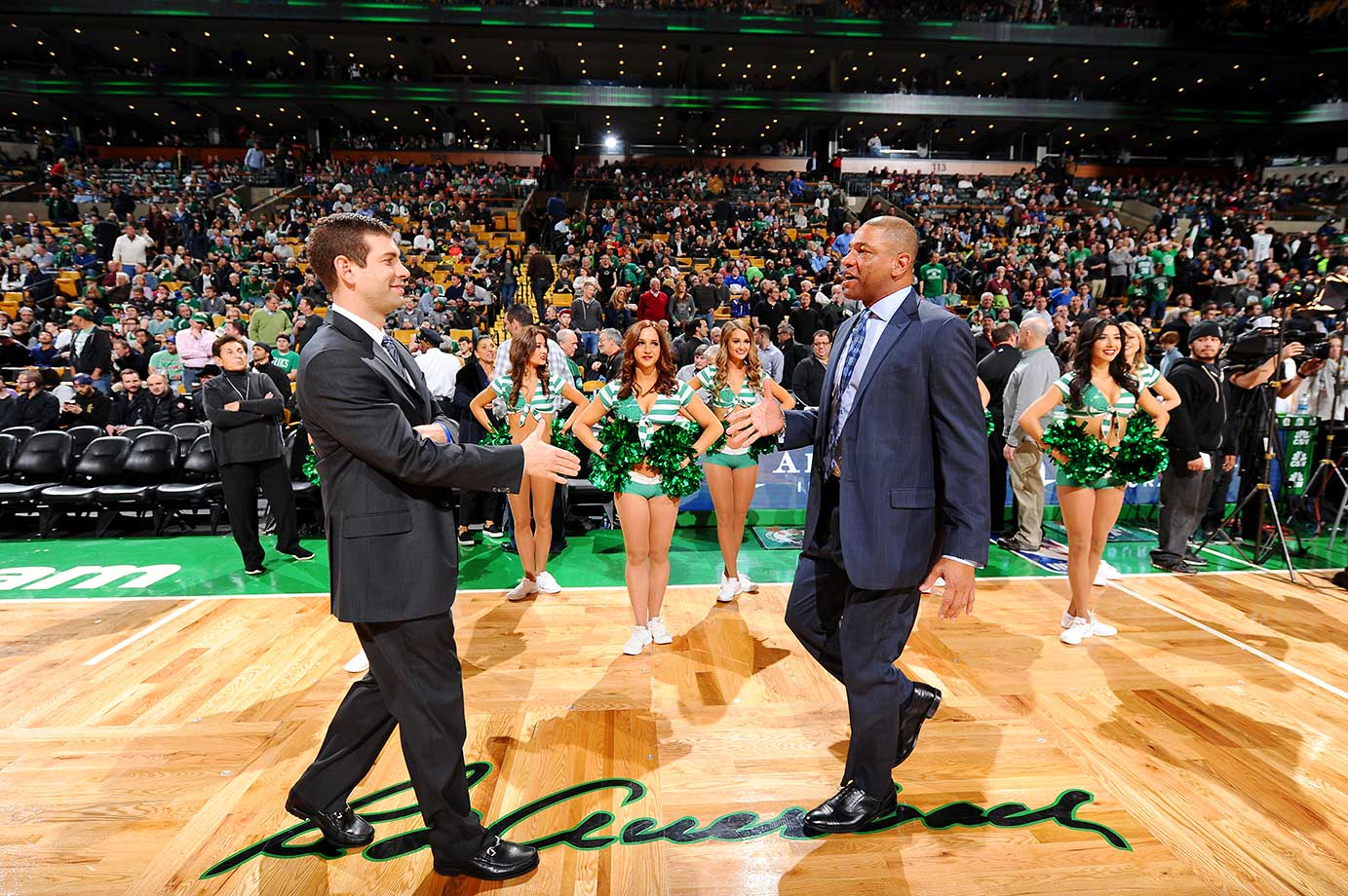 Brad Stevens of the Boston Celtics shakes hands with former Celtics coach Doc Rivers, head coach of the visiting Los Angeles Clippers.