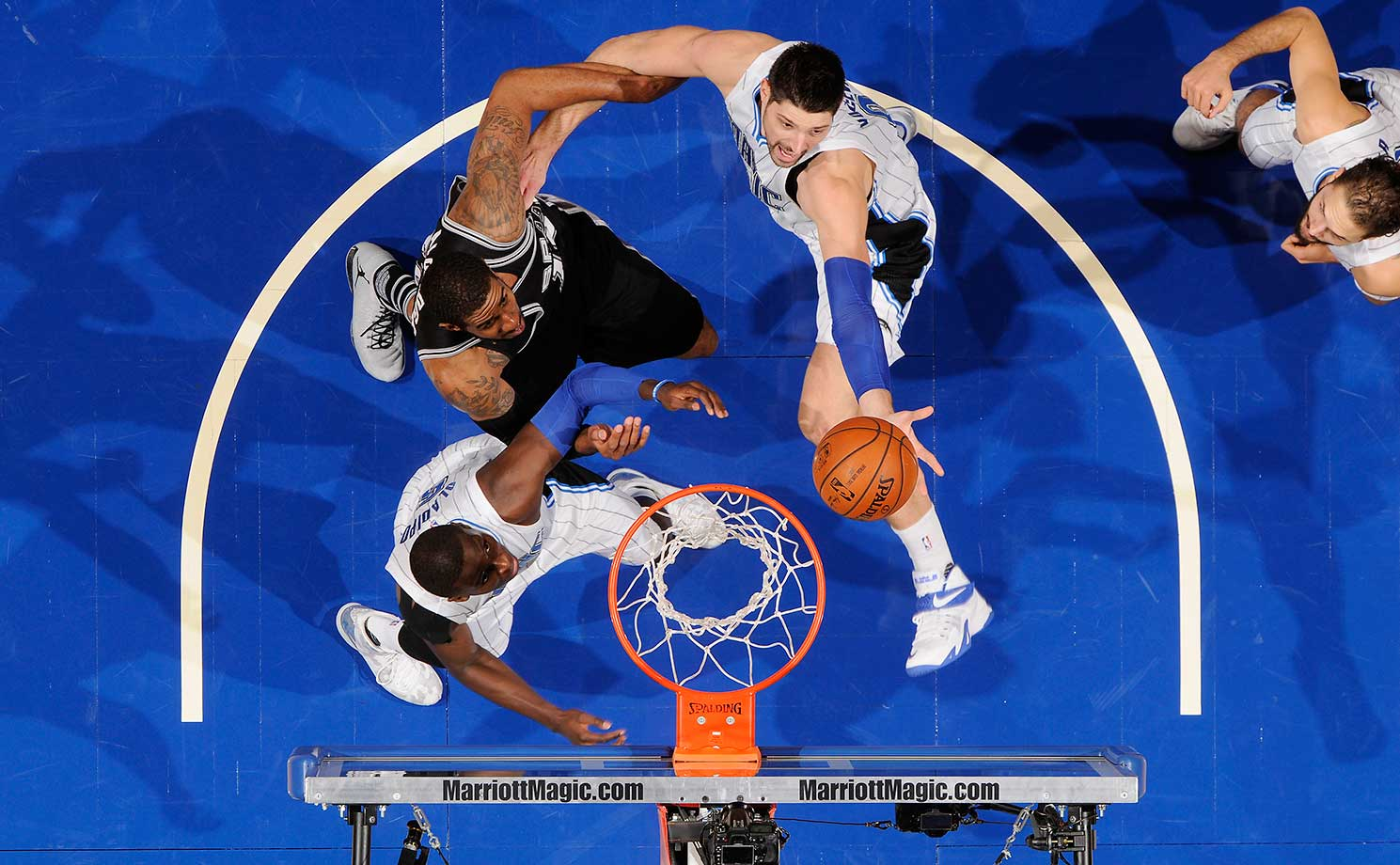 Nikola Vucevic of the Orlando Magic goes up for a rebound against the San Antonio Spurs.