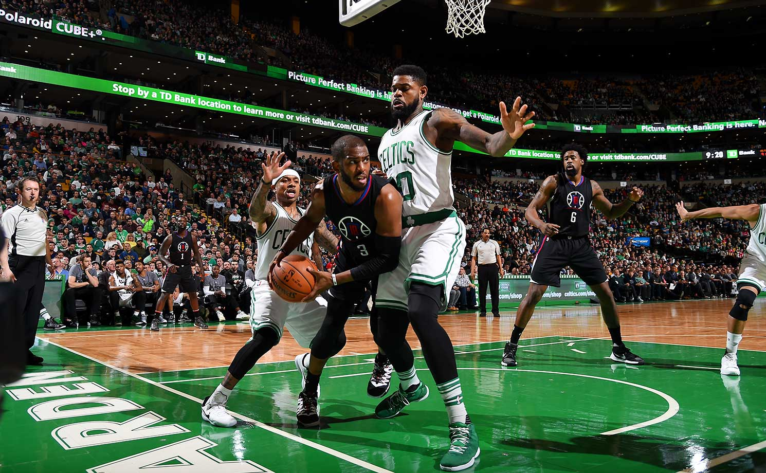 Chris Paul handles the ball against the Boston Celtics at the TD Garden.
