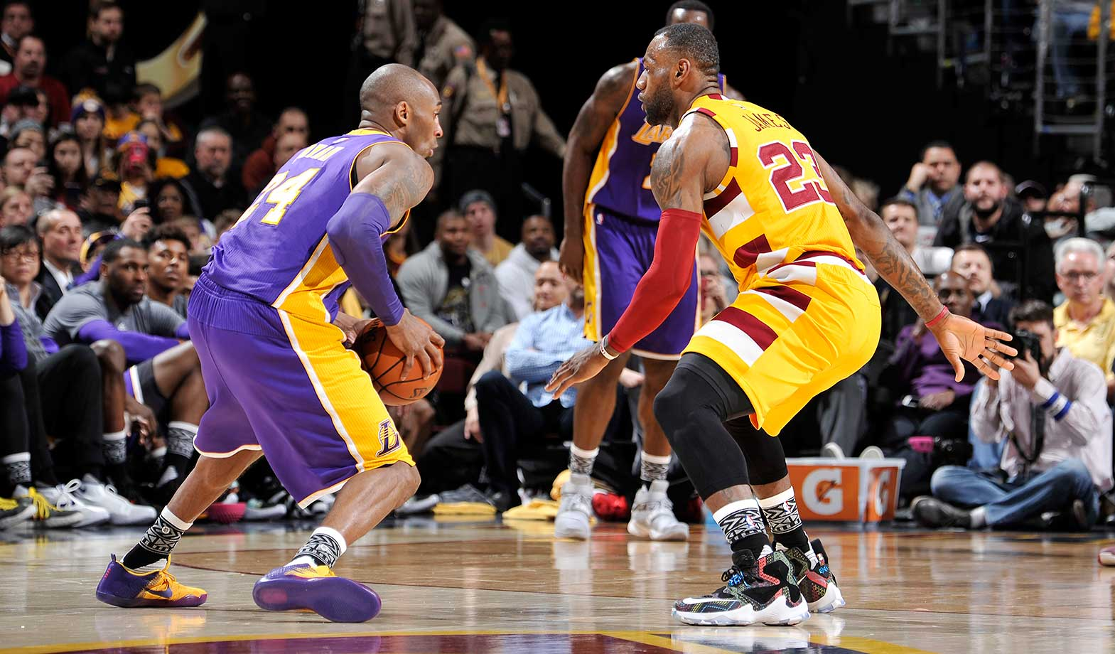 Kobe Bryant handles the ball against LeBron James at Quicken Loans Arena in Cleveland, Ohio.