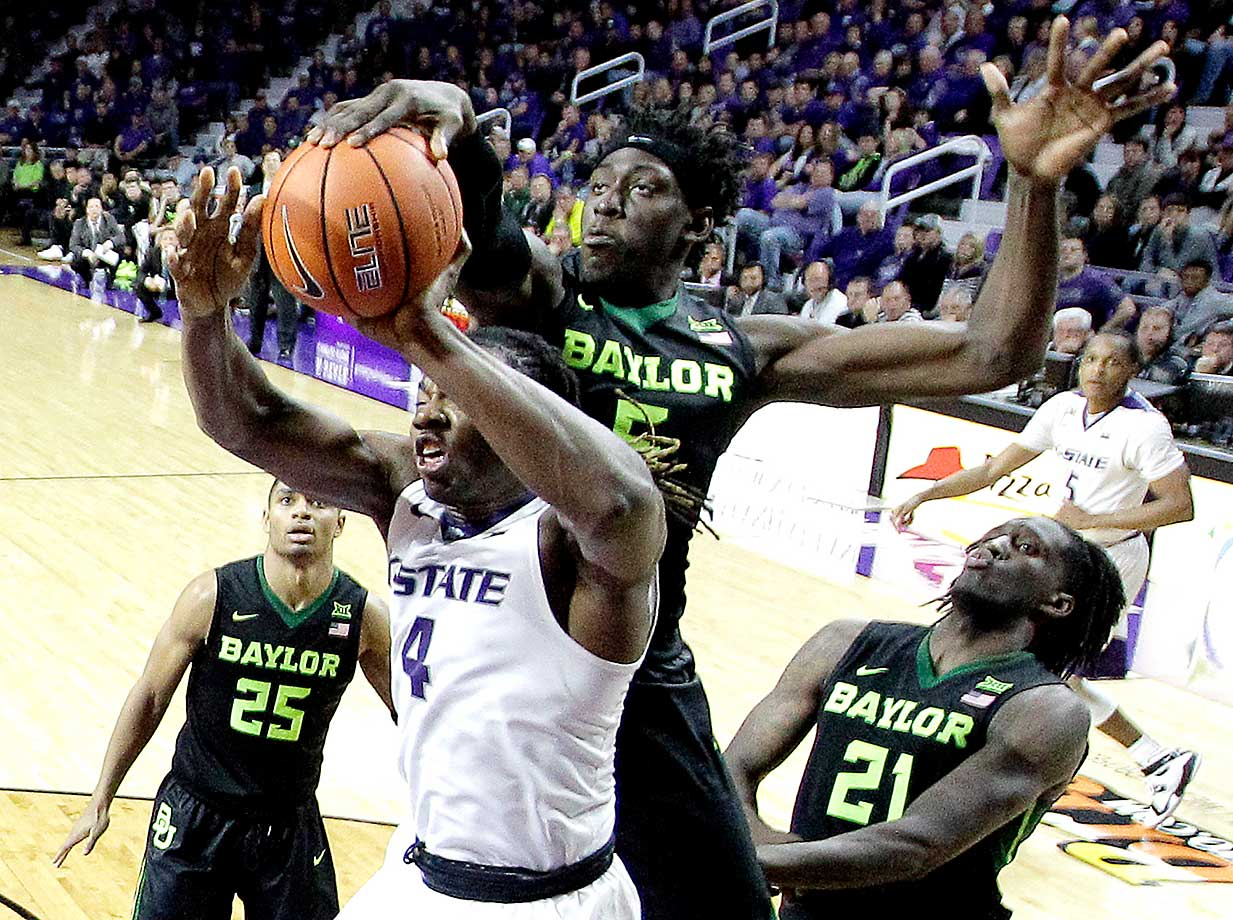 Baylor's Johnathan Motley blocks a shot by Kansas State's D.J. Johnson.