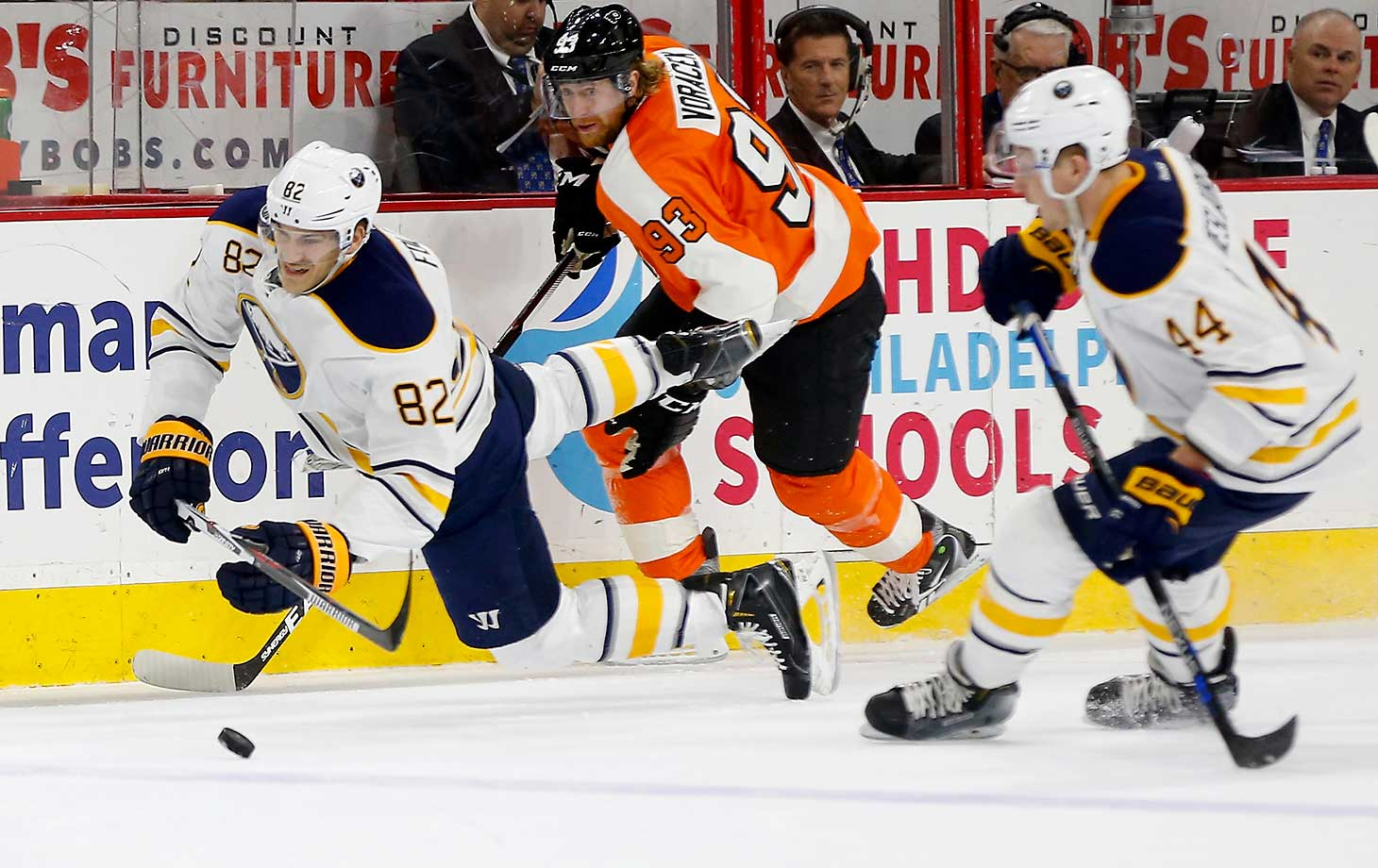 Marcus Foligno of the Buffalo Sabres is tripped up by Jakub Voracek of the Philadelphia Flyers.