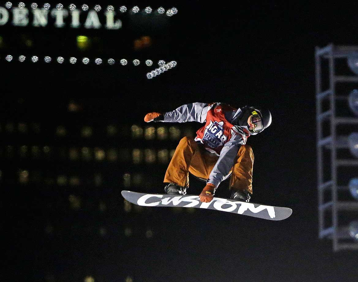 Snowboarder Michael Ciccarelli of Canada jumps during the Big Air at Fenway Park skiing and snowboarding event.
