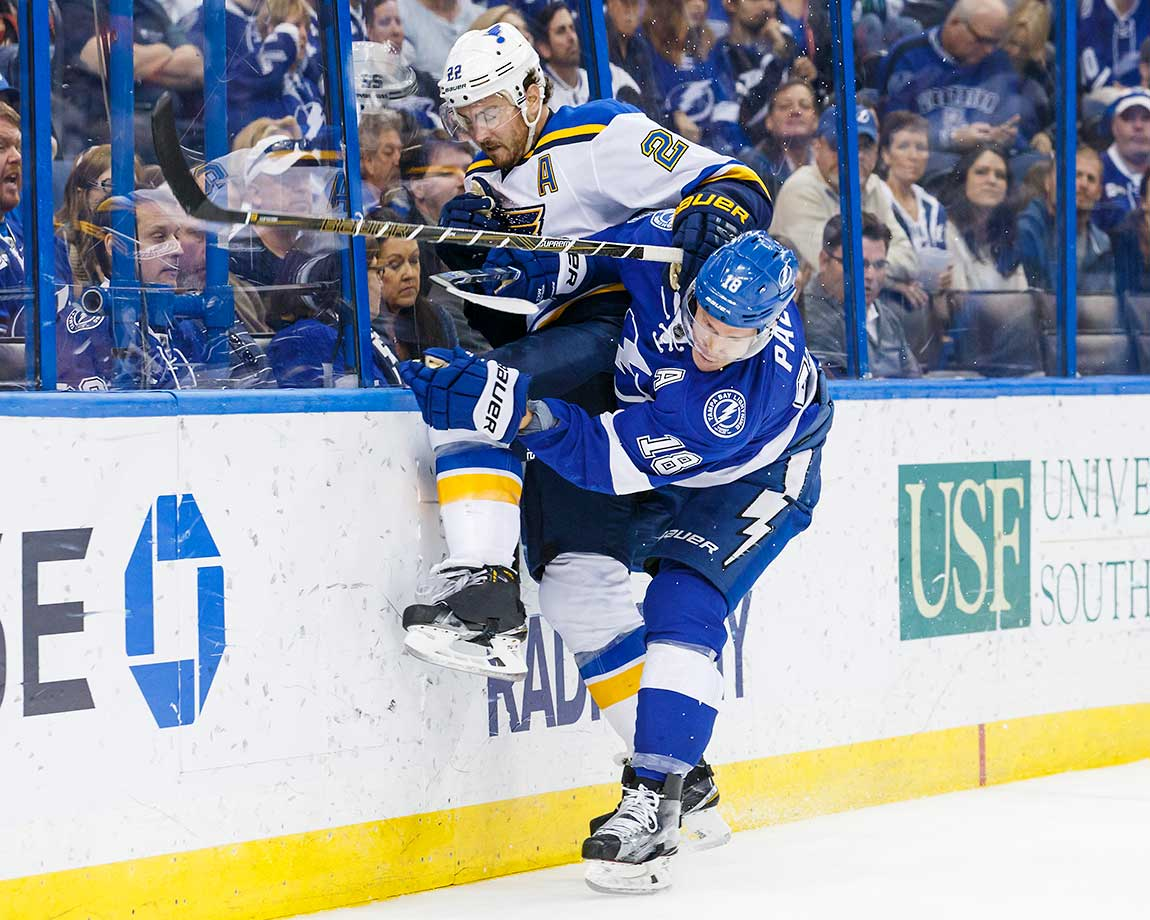 Ondrej Palat of Tampa Bay checks Kevin Shattenkirk of St. Louis Blues at the Amalie Arena in Florida.