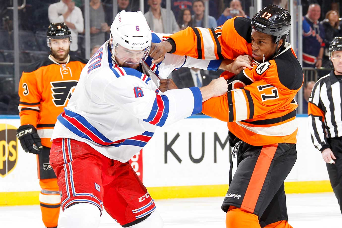 Dylan McIlrath of the New York Rangers and Wayne Simmonds of the Philadelphia Flyers get into a fight at Madison Square Garden.