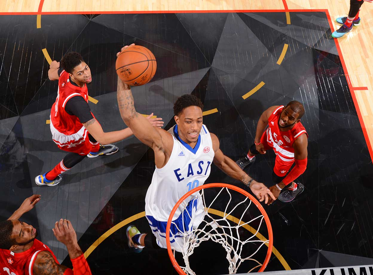 DeMar DeRozen of the Eastern Conference All-Stars goes up for the dunk.