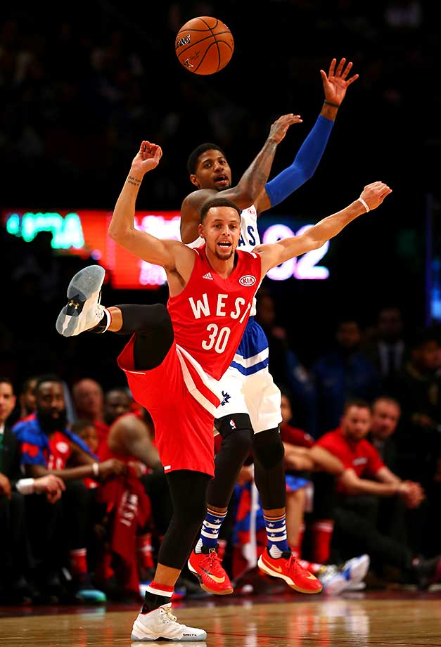 Stephen Curry competes for the ball with Paul George at the NBA All-Star Game.