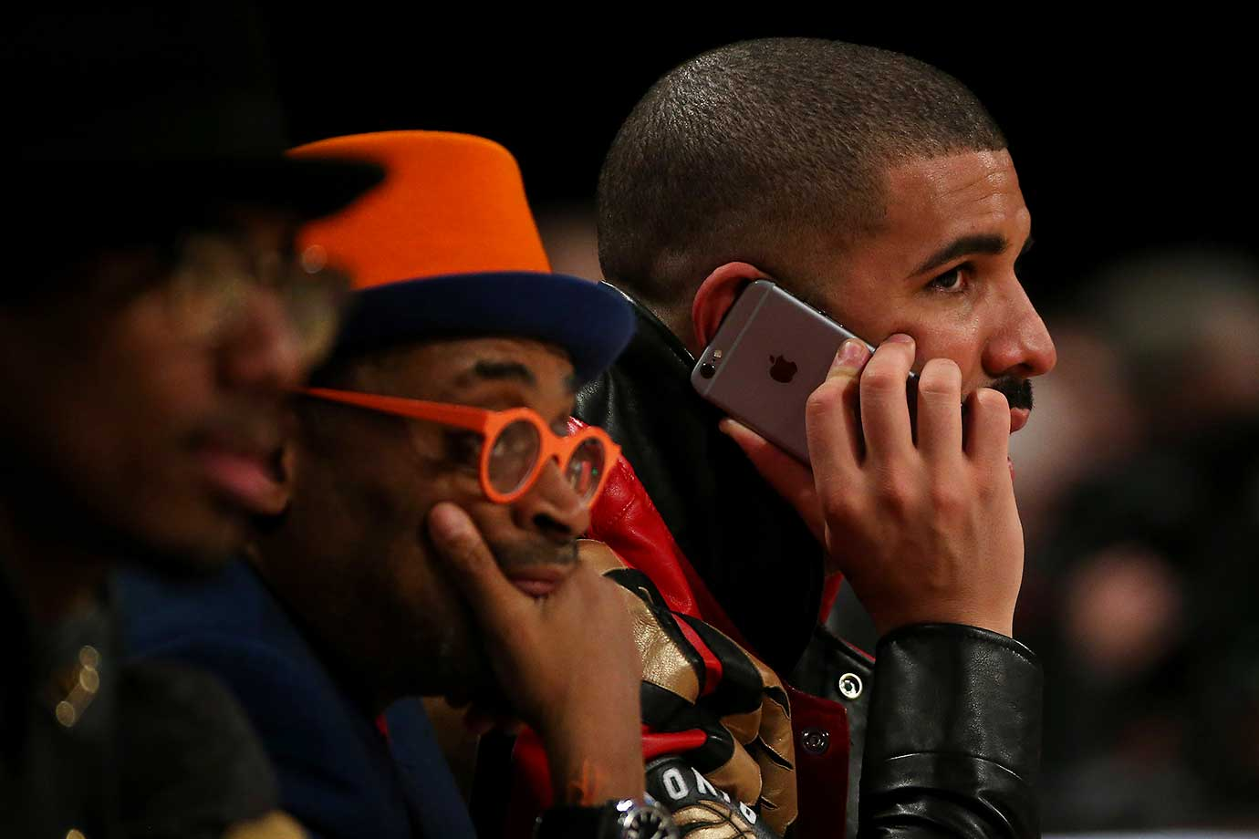 Drake makes a call on his cell phone  during the 65th NBA All-Star Game.