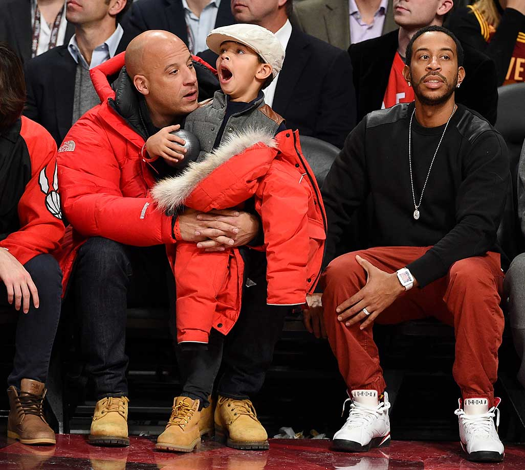 Actor Vin Diesel, son Vincent Sinclair and Ludacris attend the All-Star Game.