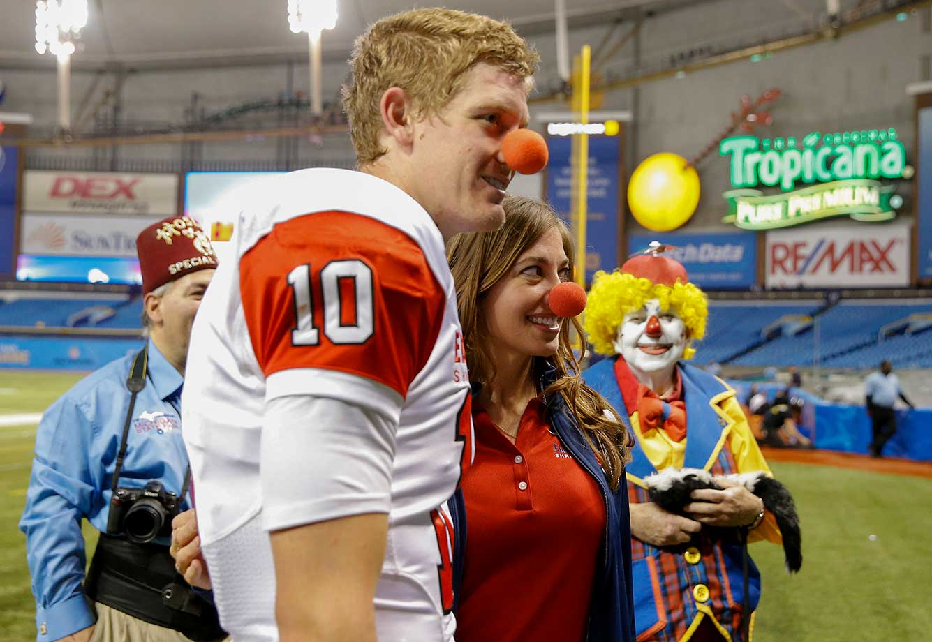 Jake Rudock from Michigan playing on the East Team poses with Shriners following the East West Shrine Game at Tropicana Field in St. Petersburg, Fla.