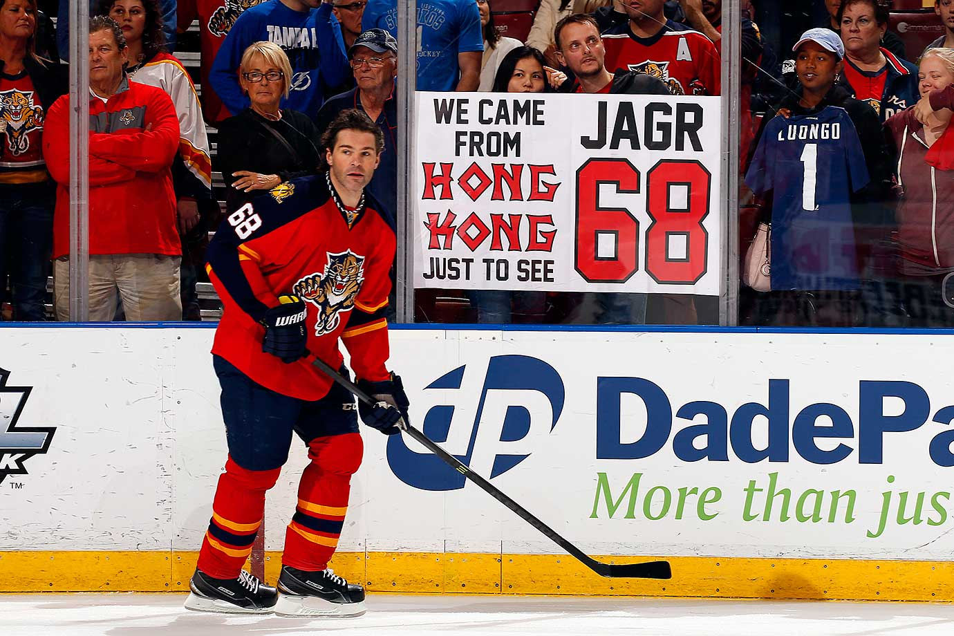 Jaromir Jagr of the Florida Panthers skates by fans that traveled all the way from Hong Kong to see him play against the Tampa Bay Lightning at the BB&T Center.