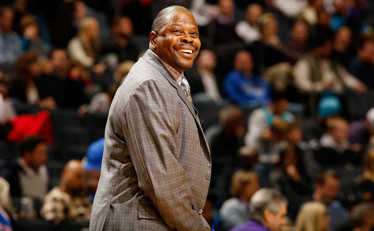 Patrick Ewing, assistant coach of the Charlotte Hornets smiles during the game against the New York Knicks at the Time Warner Cable Arena in Charlotte.