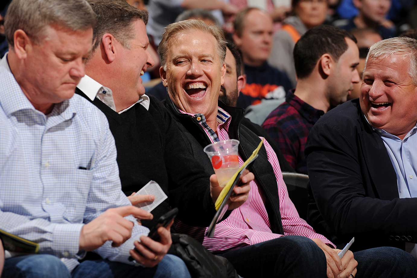 Former NFL quaterback John Elway attends the game between the Detroit Pistons and Denver Nuggets at the Pepsi Center in Denver.