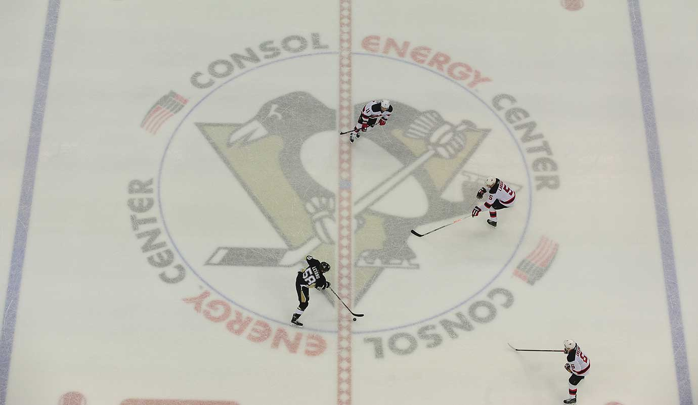 An overhead shot of the Pittsburgh Penguins home game against New Jersey with Kris Letang (58), Stephen Gionta (11) and Adam Larsson (5) on the ice.