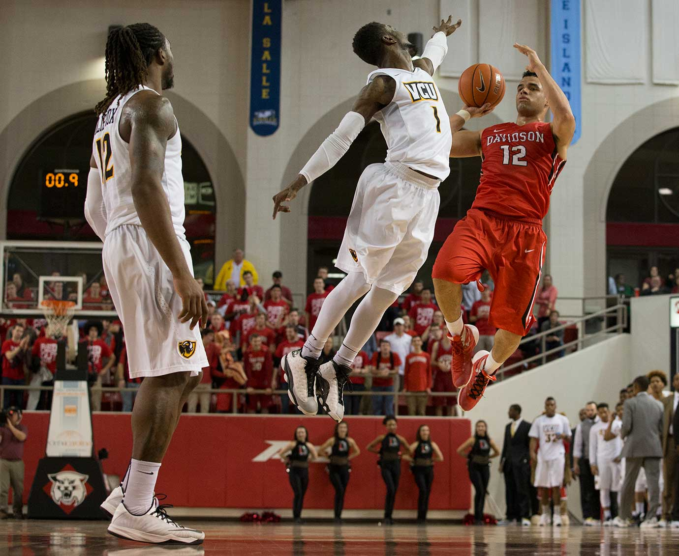 Davidson Wildcats guard Jack Gibbs tries for a three while facing Virginia Commonwealth University in Davidson, N.C.