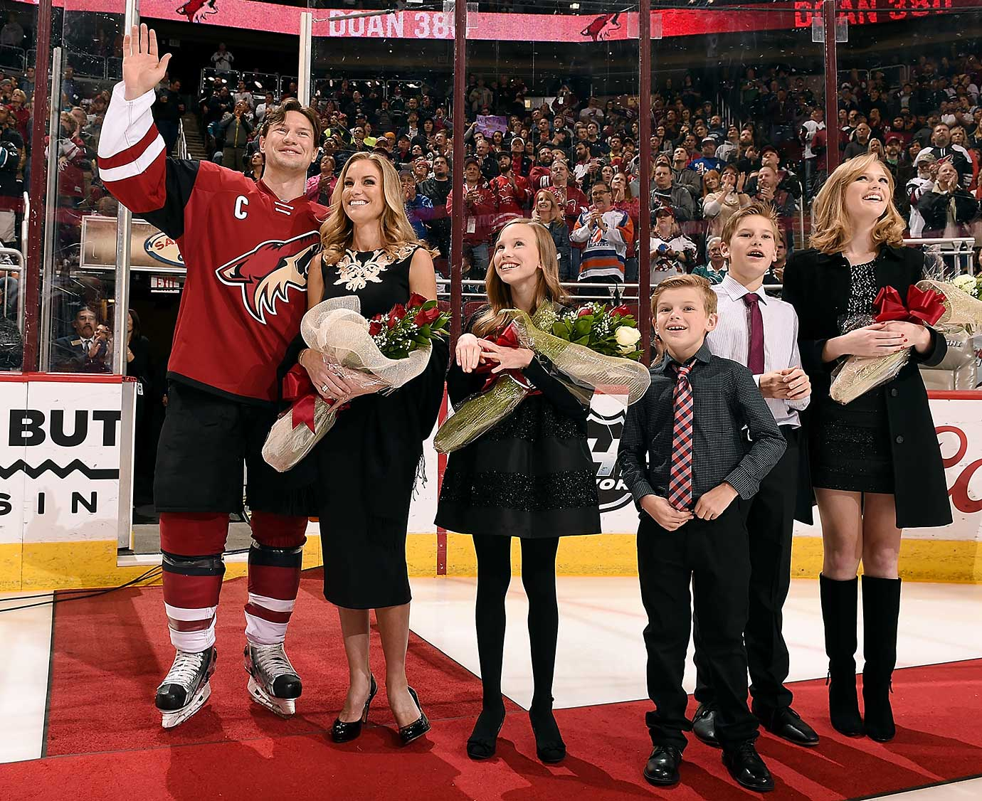 Shane Doan of the Arizona Coyotes waves to the crowd with his family during a ceremony in Glendale celebrating Doan being the all-time franchise goal scoring leader.