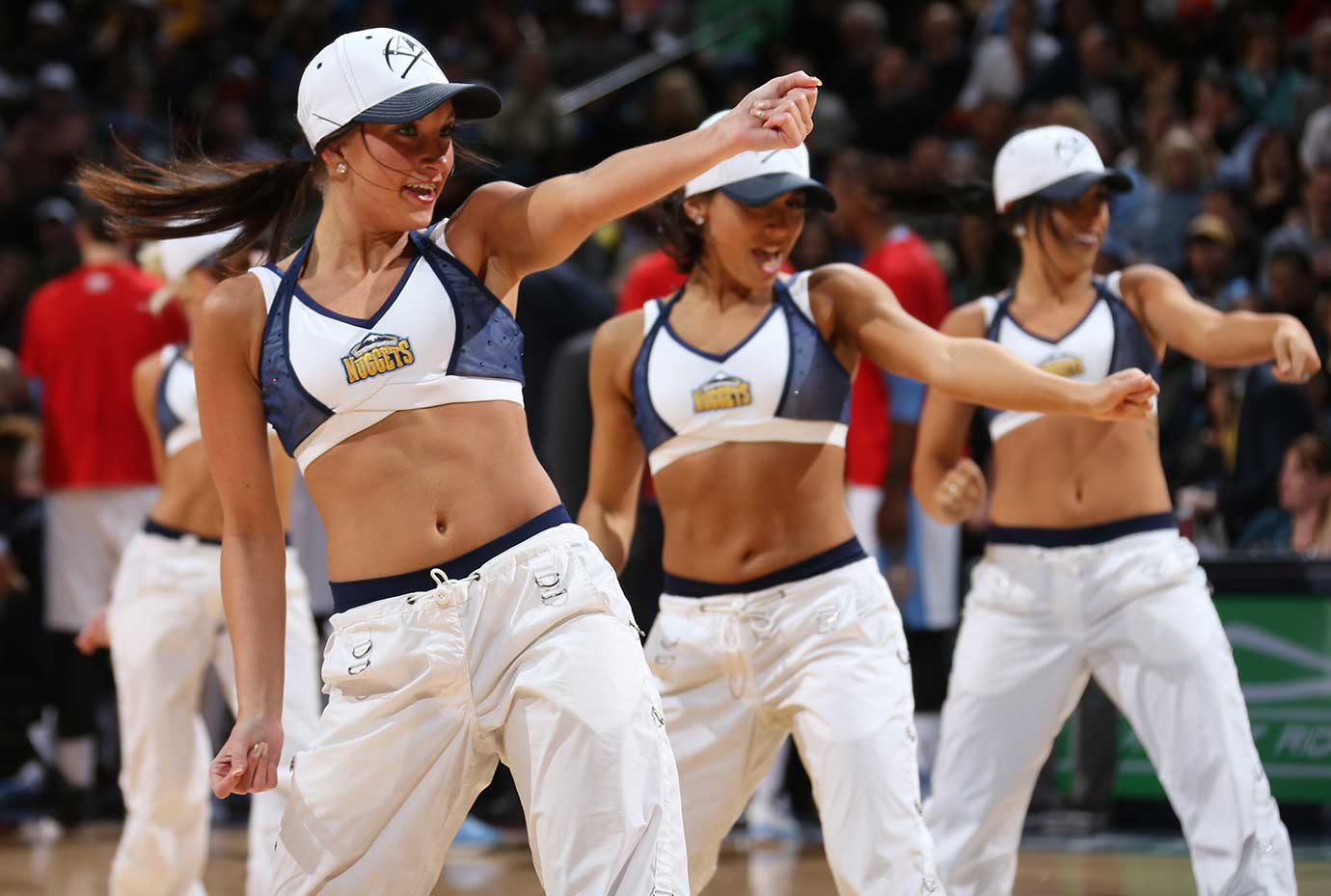 Dancers perform during the game between the Memphis Grizzlies and Denver Nuggets at the Pepsi Center in Denver.