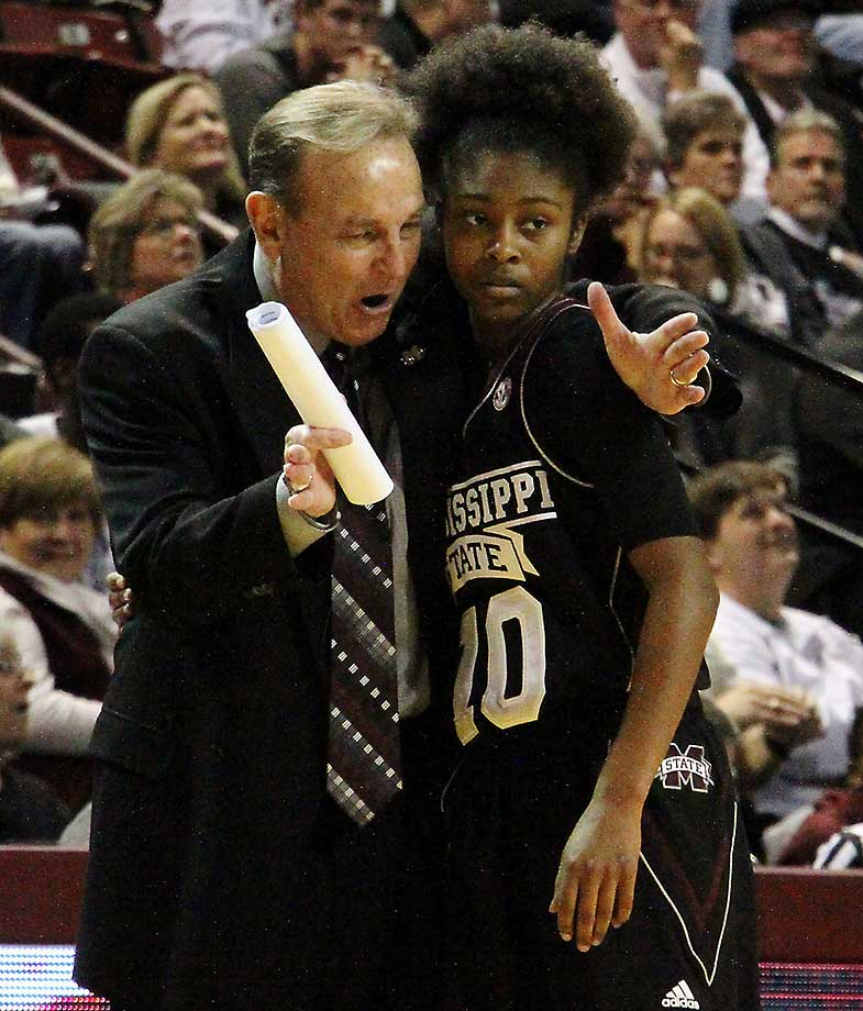 Mississippi State head coach Vic Schaefer goes over a previous play with Jazzmun Holmes during a game in Starkville, Miss. Mississippi State won 79-51.