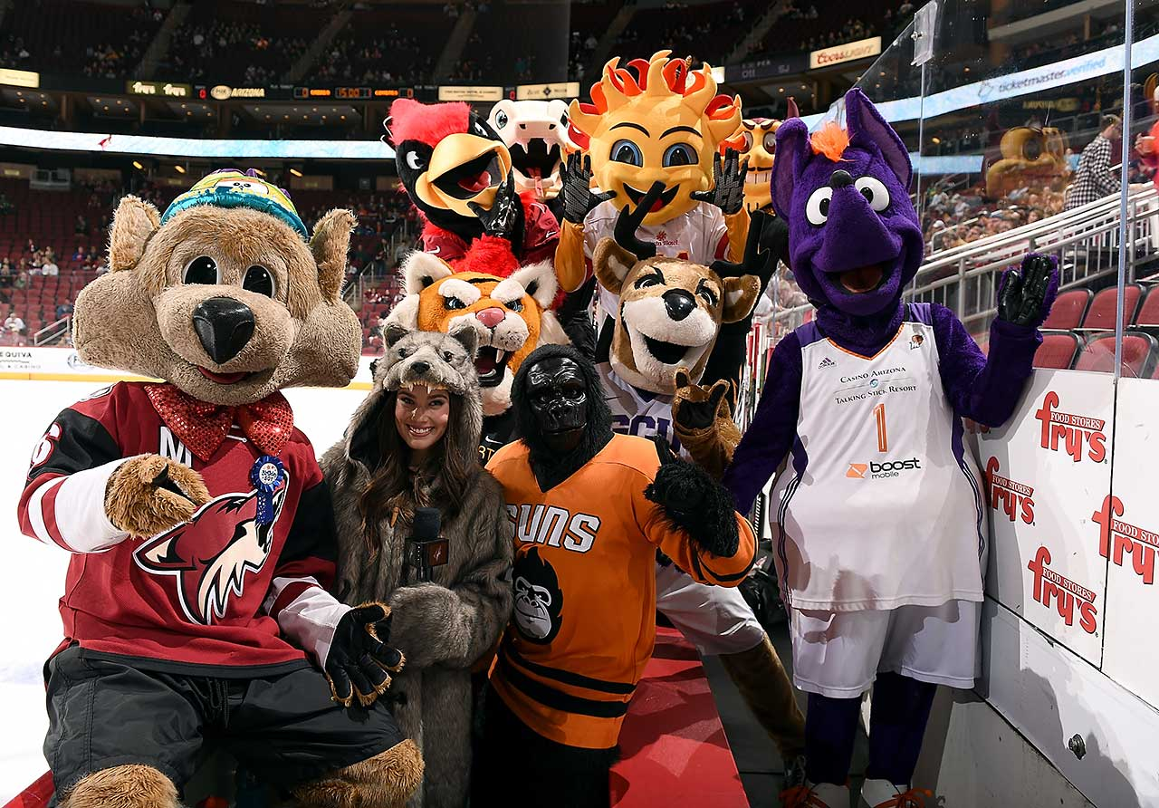 Arizona Coyotes in-game host Lindsey Smith and team mascot Howler (left) pose with other Phoenix sports team mascots to celebrate Howler's birthday before a game against the Buffalo Sabres at Gila River Arena in Glendale, Ariz.