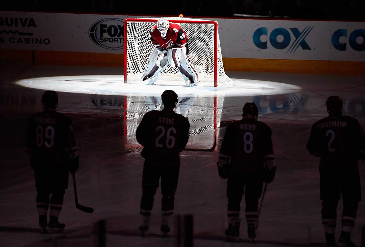 Goaltender Louis Domingue of the Arizona Coyotes is introduced before the start of the game against the Buffalo Sabres at Gila River Arena.