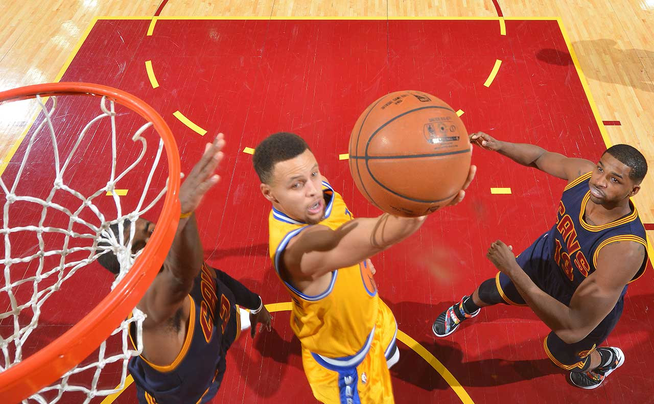 Stephen Curry of the Golden State Warriors goes up for the reverse layup against the Cleveland Cavaliers.