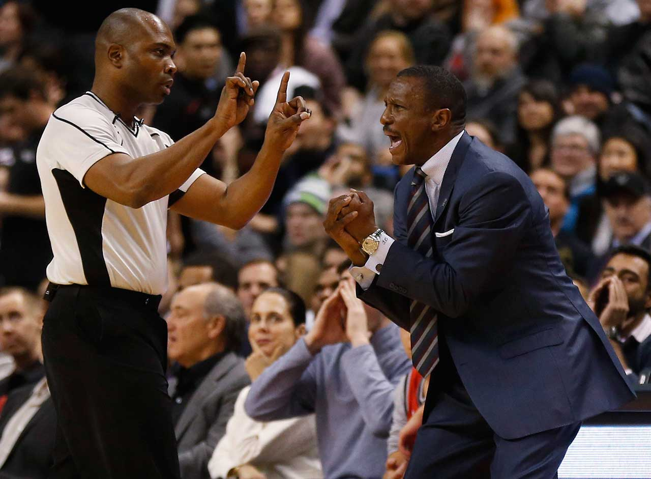 Toronto Raptors head coach Dwane Casey agues a call with referee Courtney Kirkland during a game against the Brooklyn Nets at the Air Canada Centre in Toronto, Ontario.