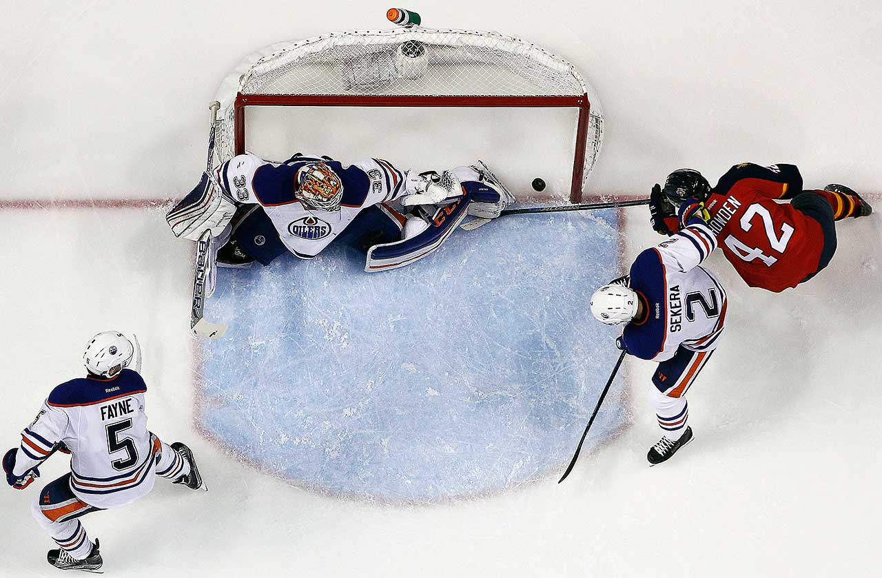 Quinton Howden of the Florida Panthers shoots and scores against Cam Talbot of the Edmonton Oilers at the BB&T Center in Sunrise, Fla.