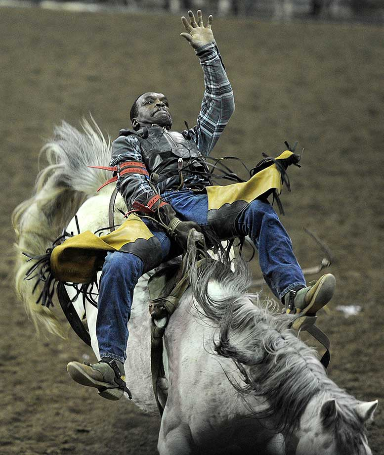 Harold Miller competes in bareback during the Martin Luther King Jr. African American Heritage Rodeo of Champions in Denver.