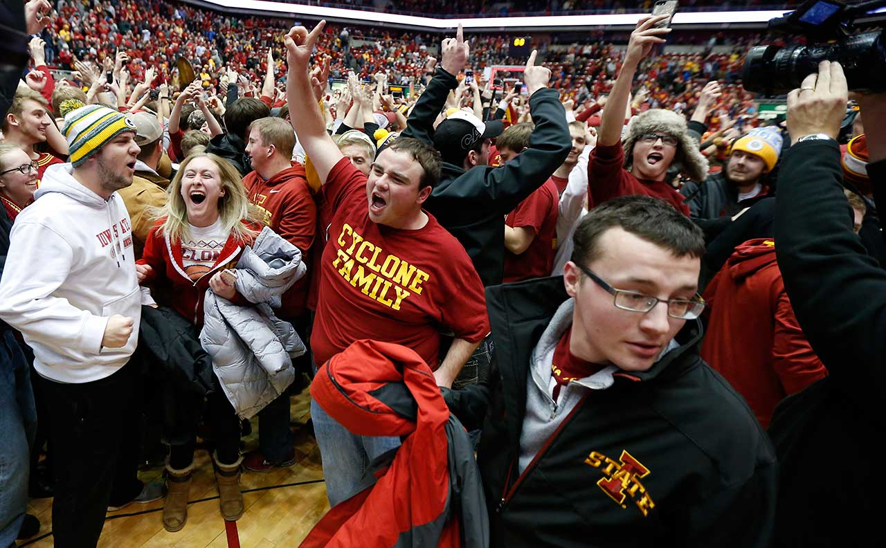 Cyclones fans storm the court after Iowa State defeated the Oklahoma Sooners 82-77 at Hilton Coliseum in Ames, Iowa.